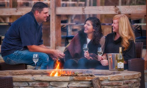 Enjoying wine by the fire at Bear Claw Vineyards in Blue Ridge, GA