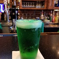 Green beer at Doolittle's on St. Patrick's Day. Notice the well-stocked bar.