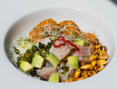Classic Peruvian ceviche with a twist: cushuros, avocado and glazed sweet potatoes.
