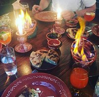 Flaming chourico. Bolo de cacao and olive started. With our prosecco sangria.