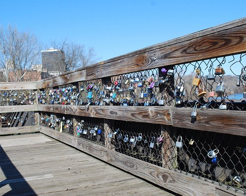 Lots of Locks of Love on scenic view platform halfway across bridge to island