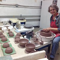Nancy Gorman, a resident artist, shows her throwing skills. See her finished work at our events.