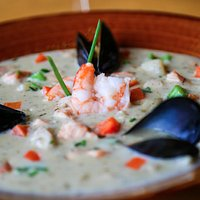 Smoked Seafood Chowder - Assorted seafood simmered in a rich creamy smoked New England style cho
