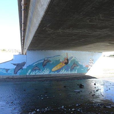 Murals under the bridge supports