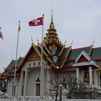 Thai and Swiss flag in front of the building.