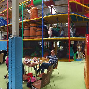 Four story play area with tons to do, a massive ball pit, and four giant slides.