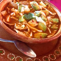 Soup with avocado and cheese