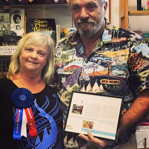 David and Christine Reed show off their SBDC Success Story award.