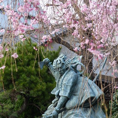 statue in cherry blssom