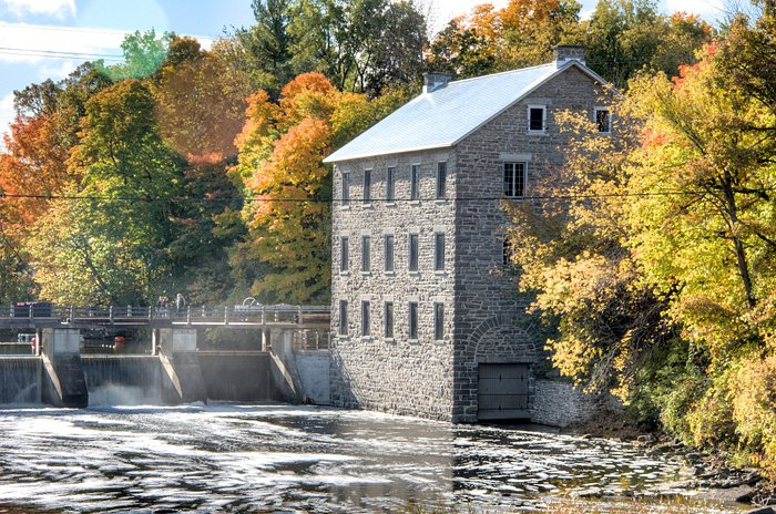 Stroll along the dam to gain a different perspective of the building.  Photo Credit: Brian Kunte