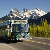 The Canmore bus headed downtown, with the Three Sisters in the background.