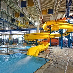 Heated leisure pool which includes water slide, lazy river, as well as many water features.