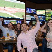 Fans enjoying the ultimate sports bar experience at BV's - just one minute from Bradley Airport