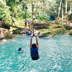 Rope Swinging at the Irie Blue Hole