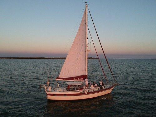 SV Lionheart under sail at sunset