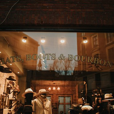 Inside this lovely place you can get a nice hat, cap, shoe or just a cold beer or a glass of bou
