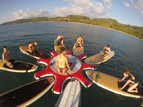 SUP YOGA. Practice and play in the ocean.