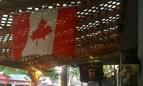 Jolly Roger and Canadian Flag hang from the restaurant