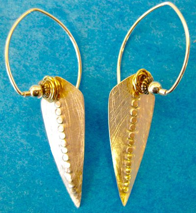 Handmade sterling earrings with additional elements.