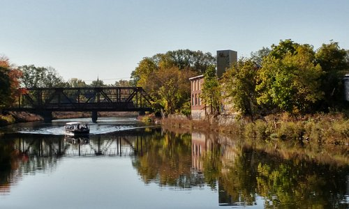 Learn about the historic city of Woonsocket, its architecture, and numerous bridges