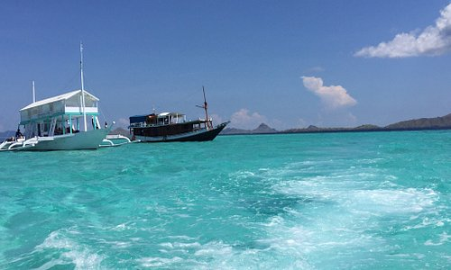 Small island with white sand , water is stunning color which is clear tosca ,it is the sign narr