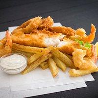 Fisherman's box.Fish, Calamari, Prawns, chips and a sauce