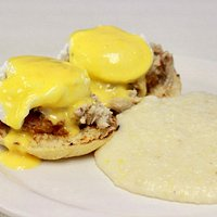 Fried green tomato and creamy crab benedict topped with homemade hollandaise sauce