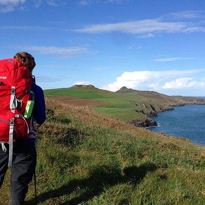 Walker on a multi-day trip along the Pembrokeshire Coastal Trail