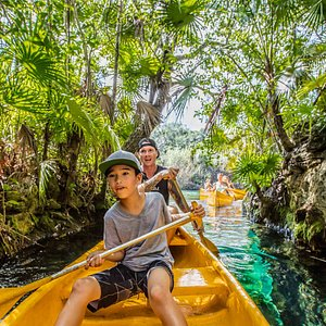 Our Mayan Jungle tour takes you canoeing, zip lining and cliff jumping on a private property.