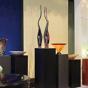 Pendant and accent lights along with vessels.