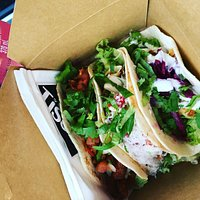 Three authentic Mexican tacos served in a box