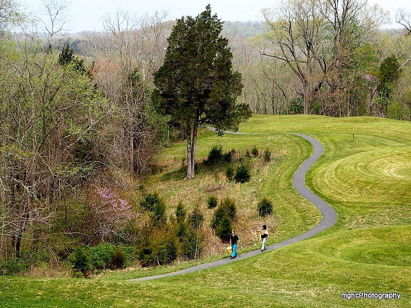 Paved walkway and view of the Serpent Mound
