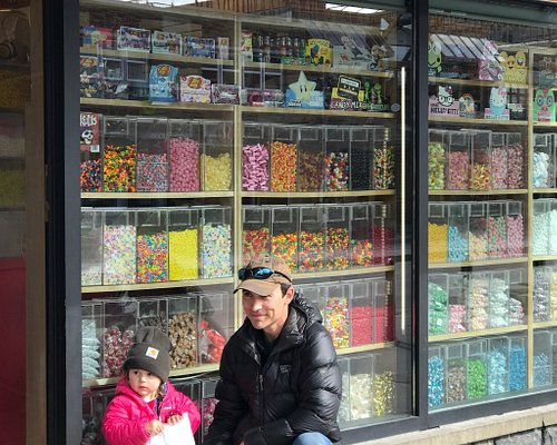 In front of the candy shop!