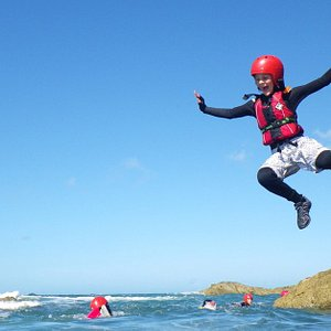 Children and families on an adventure day out with Celtic Quest Coasteering in Pembrokeshire