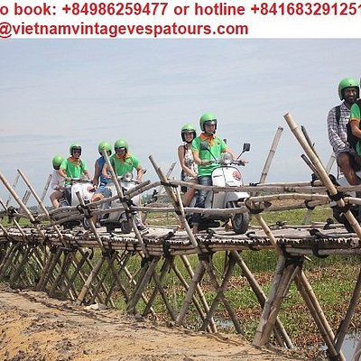 hoi an vespa tour ride one the bamboo bridge