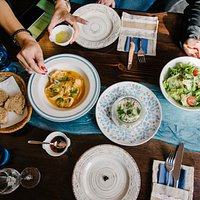 The Blue table - always full with delicious dishes and happy people