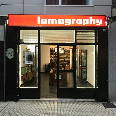 """Lomography Embassy Gijón"" storefront at night"