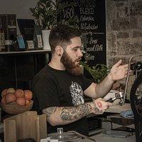 Barista Stanko Jurisic pouring his shots from our La Marzocco Strada