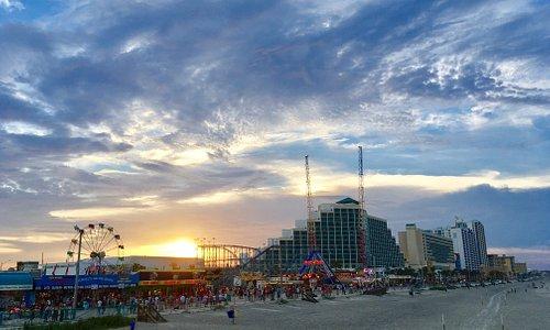 Daytona Beach Boardwalk and Amusements at sunset.