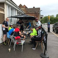 Group 1 chowing down on a sausage & bacon roll