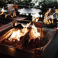 Cosy outdoor seating with fireplace