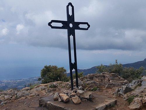 Metal cross at summit