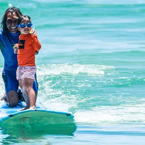 Sparky teaching a 5 year old - you're never too young to learn to surf!