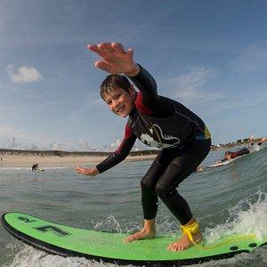 Kids enjoying surfing at Kerlouan