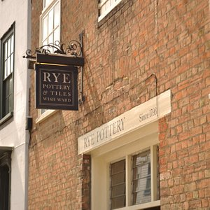 Rye Pottery's shop in the centre of town is in a former Brewery with sizeable beams & exposed br