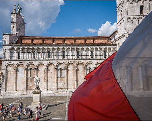 Piazza St. Michelle in Lucca with Italian flag