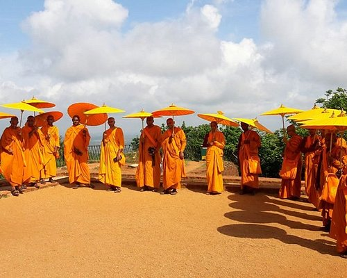 Buddhist monks on the summit of the Sigiriya rock fortress.