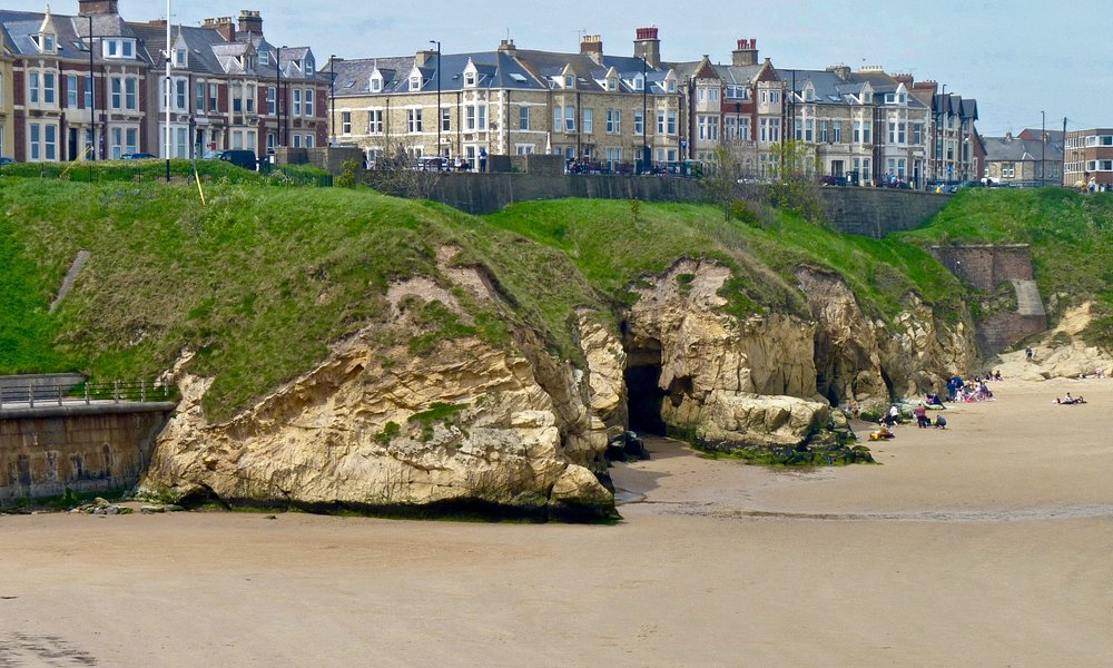 Protruding cliffs at Cullercoats Beach - high tide reaches right up to these!
