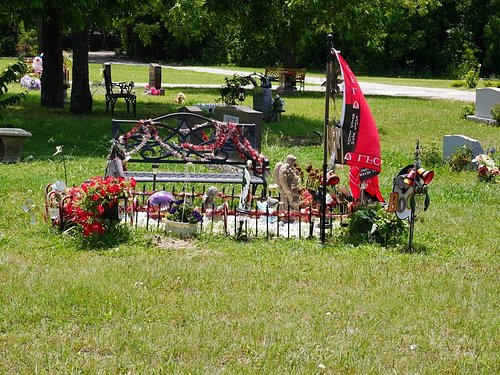 Newer part of cemetery...benches, decorated plots are common