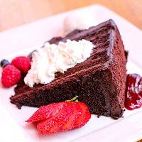 6 layer Chocolate Cake! A bombucha 3/4 pound slice of chocolate cake, raspberry coulis, fresh wh